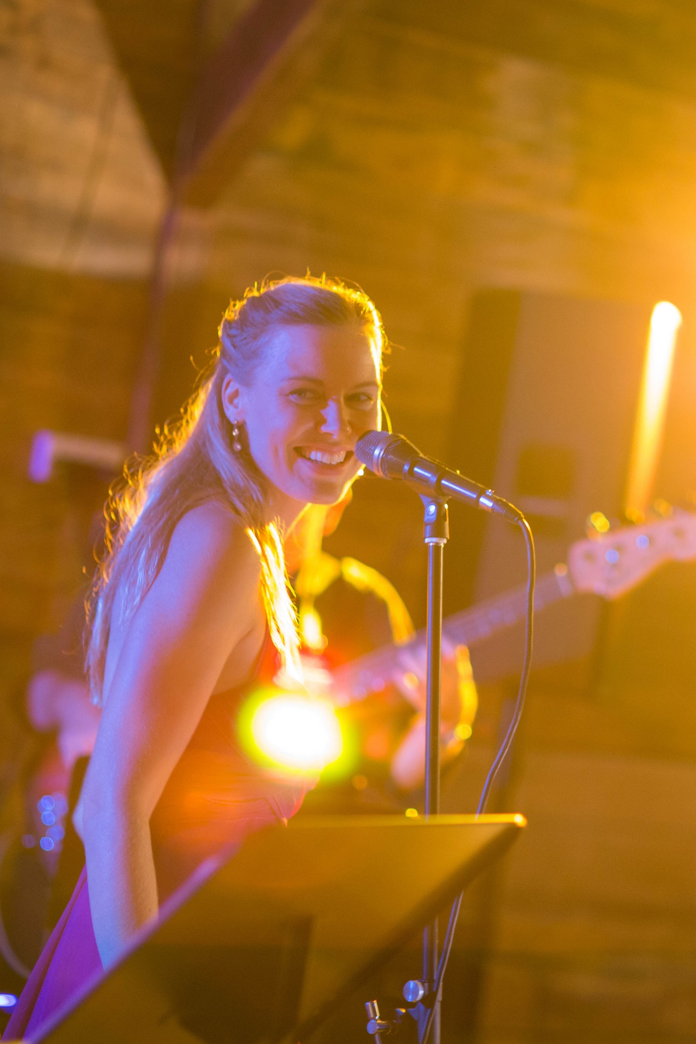 Andrea Allumay performing at a private event with band